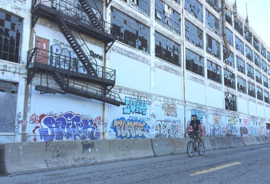 Mike Darga rides past the derelict Albert Khan-designed Fisher Body 21 plant, where his father worked for 30 years. Civil engineer Darga gives auto heritage tours for Wheelhouse Detroit.