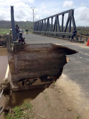 A bridge ripped apart by the storm.