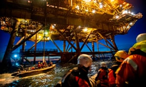 Greenpeace activists from the Netherlands, Germany and Denmark boarding two oil platforms in Shell's Brent field in the North Sea in October.