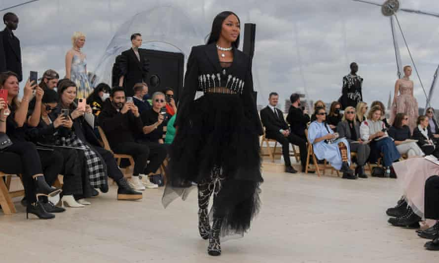 Naomi Campbell in black tulle flecked with crystal raindrops.
