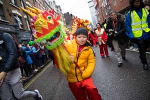 A child leads a parade