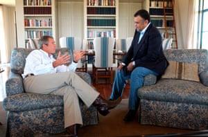 President George W Bush speaks to Saudi ambassador Prince Bandar in Crawford, Texas in 2002.