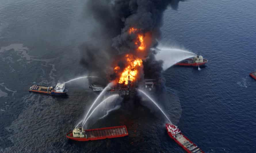 Aerial photo of fireboats surrounding the Deepwater Horizon rig and attempting to douse the flames with water jets