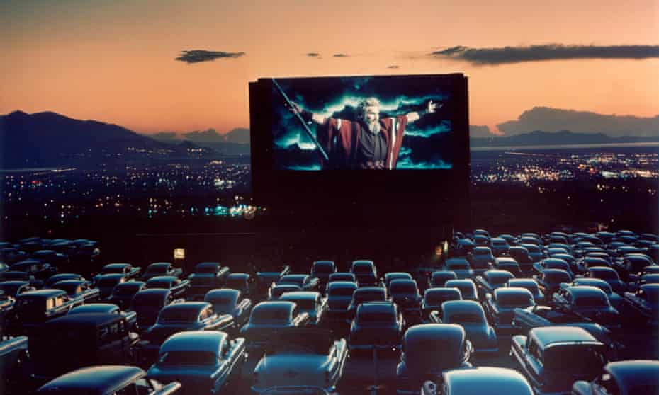 Actor Charlton Heston as Moses w. arms flung wide. UTAH, UNITED STATES - 1958: Actor Charlton Heston as Moses with arms flung wide appearing in motion picture The Ten Commandments as it is shown at drive-in movie theater.