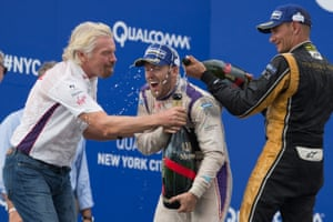 Richard Branson, left, and Stephane Sarrazin dump champagne on DS Virgin Racing driver Sam Bird following Bird's win