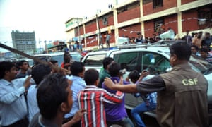 People attack the convoy of Bangladesh's main opposition leader Khaleda Zia, in Dhaka.