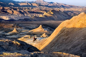 Bamiyan province, 2006: A man rides a donkey through the desert