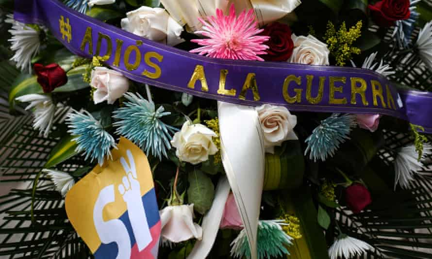 A wreath in the main square in Cali, Colombia, with a ribbon reading 'Farewell to the War'.