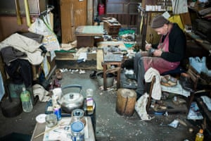 This traditional old shoemakers opened in the 1930s, and the man in the photo is the grandson of the original owner