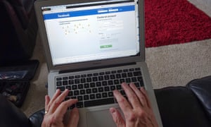 Man on laptop with Facebook home page