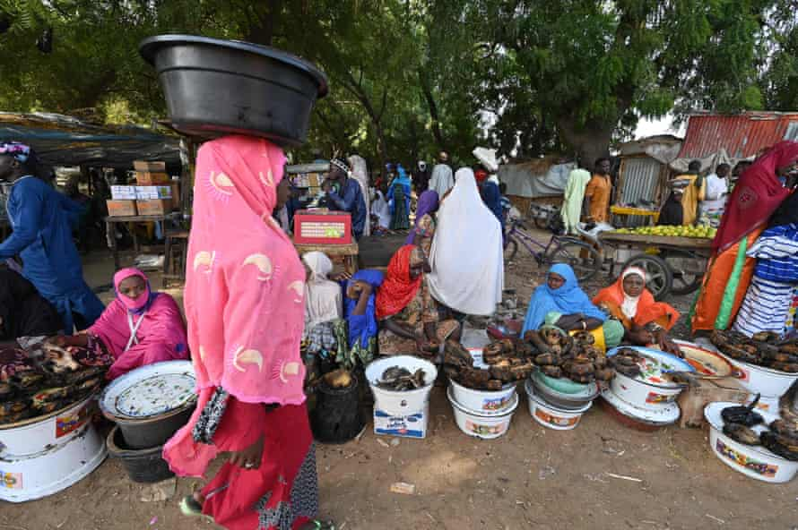 Vendors sell fish at a market in Diffa, in south-eastern Niger, on 23 December 2020, a few days before the country voted in presidential elections.