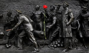 A rose is placed on a statue in Sevastopol.