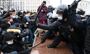 Protesters clash with riot police during a rally in support of jailed opposition leader Alexei Navalny in downtown Moscow