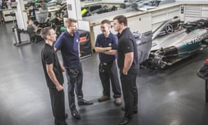 Mercedes-Benz apprentices lend a hand in run up to a Grand Prix race.