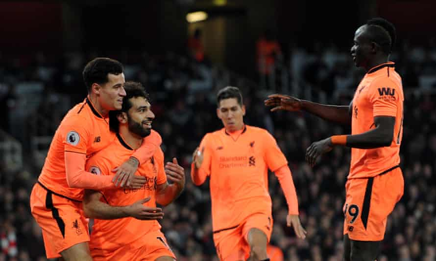 Mohamed Salah, second left, celebrates scoring Liverpool's second goal with Philippe Coutinho, left, Roberto Firmino and Sadio Mané, right.