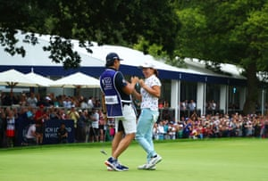 Hinako Shibuno celebrates with her caddie as she holes the winning putt on the 18th.