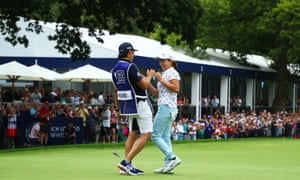 Hinako Shibuno of Japan and her caddie are overjoyed after she had just holed the winning putt.