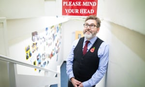 Principal of Grove Academy, John Warren, standing on the stairs to the school's basement, during a break.
