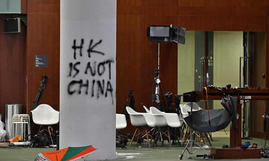 Graffiti and umbrellas outside the main chamber of the Hong Kong legislative council, two days after protesters broke into the complex.