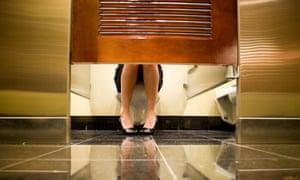 Woman on toilet.