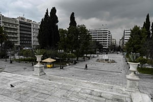 A woman crosses Athens' empty Syntagma square on Monday, when health authorities reported 71 new cases of coronavirus