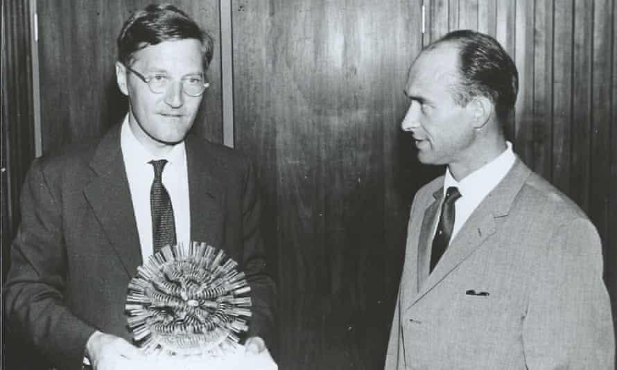 Professor Tony Waterson (left) holding a model of a virus.