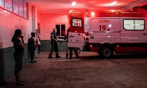 Nurses transport a patient infected with coronavirus to the 28 de Agosto Hospital, in Manaos, Brazil, 4 January 2021.