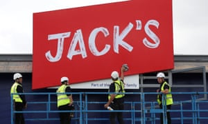 Workers unveil the branding at Tesco's new discount supermarket Jack's, in Chatteris, Cambridgeshire.