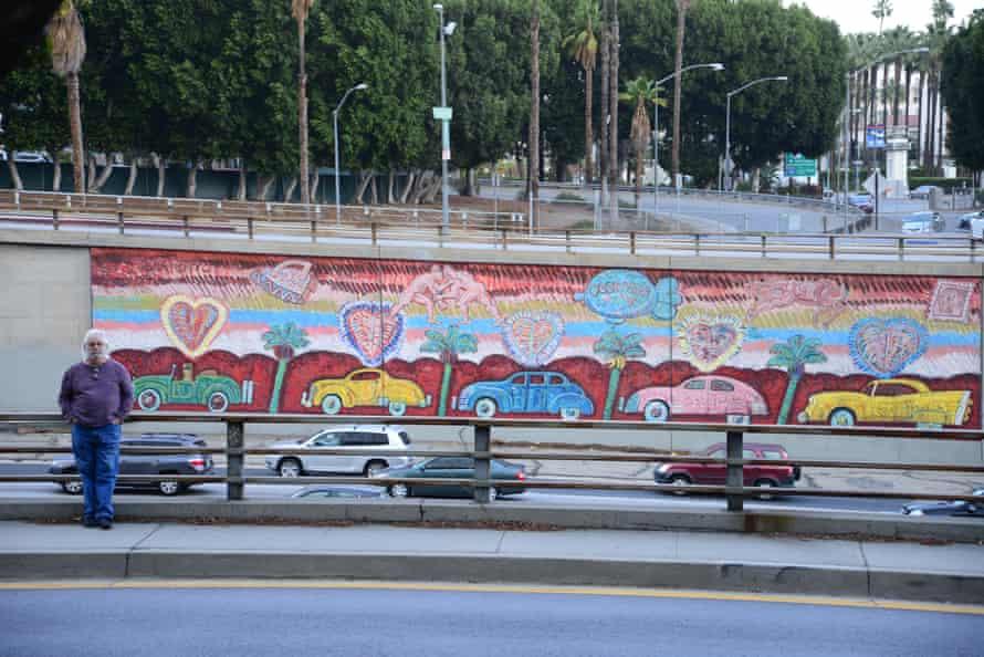 Frank Romero with his freeway mural
