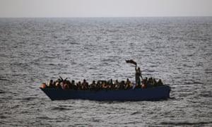 Crowded boat on sea