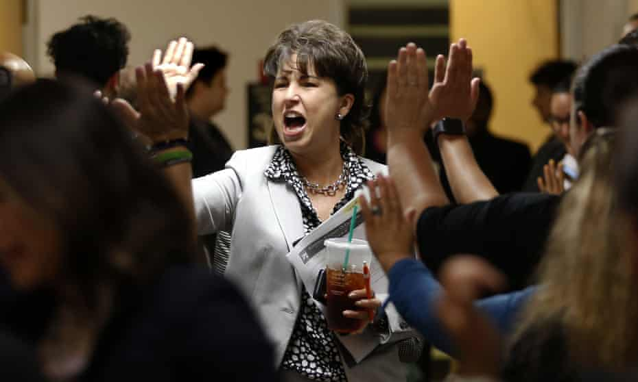 Senator Connie Leyva high-fives supporters in the hallway of the capitol building in Sacramento, California, in 2019.