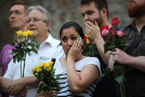 A woman looks tearful as she attends a vigil outside Finsbury Park Mosque.
