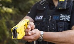 A police officer holding a stun gun
