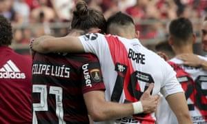 Filipe Luis of Brazil's Flamengo, left, embraces Rafael Borre of Argentina's River Plate.