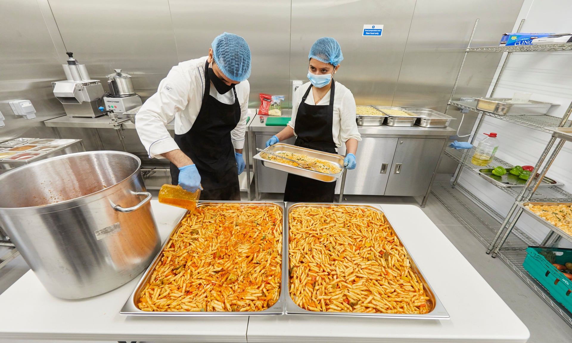 Meals being prepared at Akshaya Patra's kitchen in Watford. Photograph: David Levene/The Guardian
