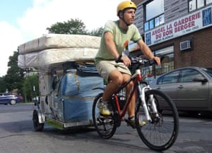 Derek Colley, of removals firm Demenagement Myette, moves a load by bike on Moving Day 2013. Professional movers in Montreal are quadruple-booked at this time of year.