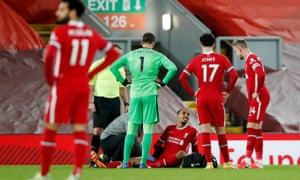 Liverpool's Joel Matip receives medical attention.