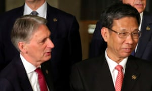 Britain's chancellor of the exchequer, Philip Hammond, with China's finance minister, Liu Kun.
