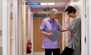 nurse comforting standing patient