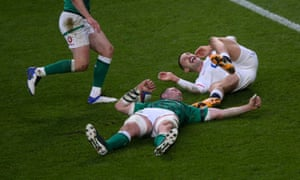 Jonny May of England celbebrates after racing past Peter O'Mahony to score his second try,.