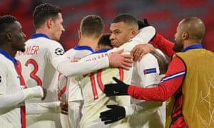 Kylian Mbappe is mobbed by teammates after scoring the third.