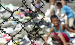 Children scavenge through rubbish in the notorious Smokey Mountain dump in Manila.