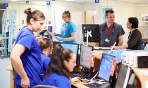 Social services community care officer Nicola Todd (far right) and advanced nurse practitioner Adrian Llewellyn-Jones at the QMC in Nottingham