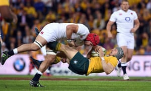 James Haskell sends Australia's David Pocock tumbling with a huge tackle.