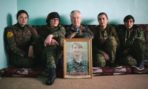 Dirk Campbell holding a portrait of his daughter Anna, in Anna: The Woman Who Went to Fight Isis.