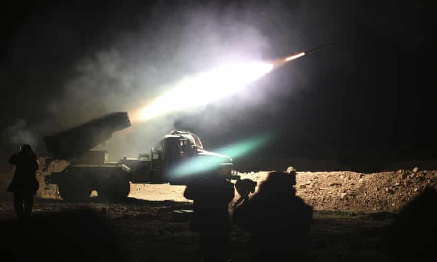 Syrian army soldiers fire a rocket at Isis positions in Raqqa, Syria.