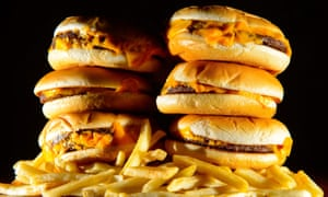 A pile of burgers and chips