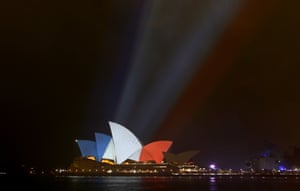The sails of the Sydney Opera House are illuminated in the colours of the French flag following the Paris terror attacks.