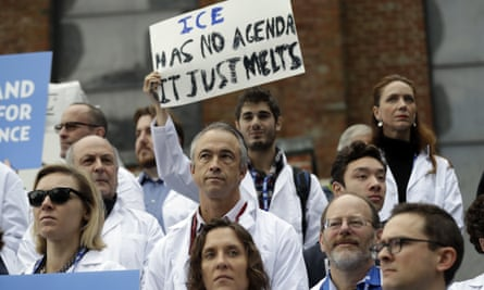 Scientists hold signs during a rally in conjunction with the American Geophysical Union's fall meeting.