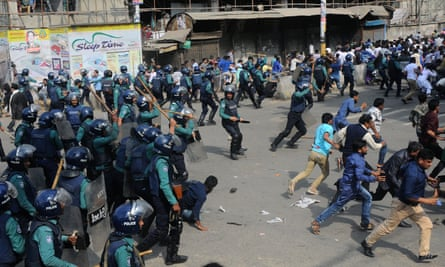 Police charge towards protesters in Dhaka.